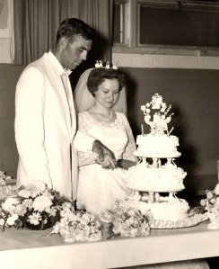 Mom and Dad cutting their wedding cake, June 5, 1965