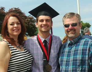 The happy graduate with me and his dad, that cute blonde boy from Freshman Orientation all those years ago.