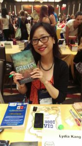 Lydia Kang, one of the authors Emily asked me to visit, was kind enough to sign Em's book and pose for a pic